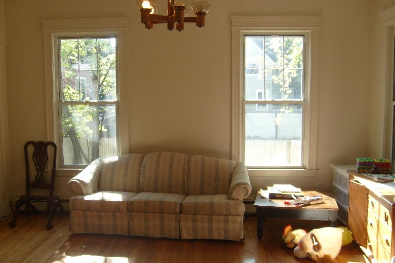 HUGE 2 bedroom with high ceilings, porch, hdwd floors, and parking!