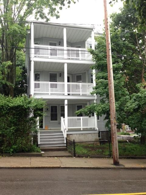 Third floor renovated apartment with 2 baths, porch.New kitchen/baths