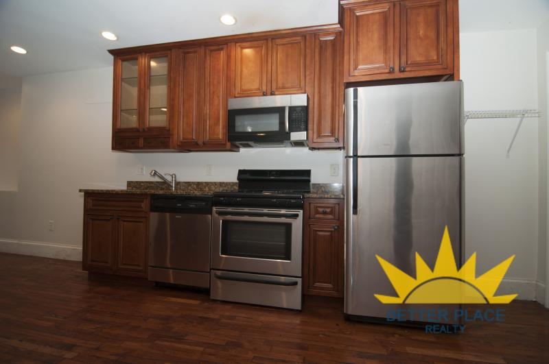 4 Bed 2 bath renovated unit! Central A/C laundry in unit! Hillside St!